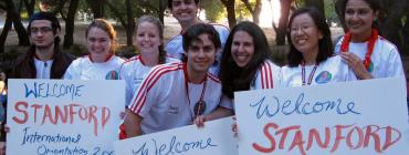 Picture of students holding welcome signs
