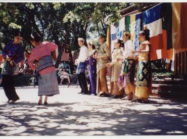 People dancing outside in an older photograph from 1997