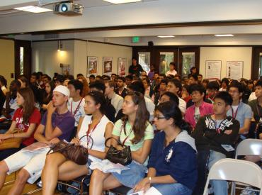 Students in an audience listening to a presentation